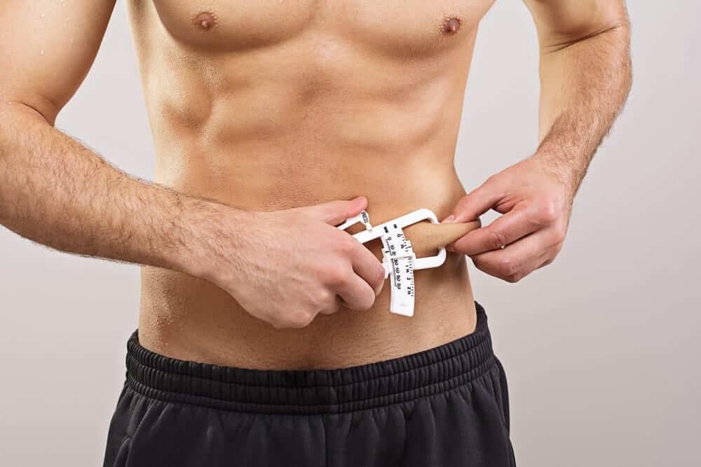 измерить жир на животе